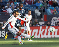 New England Revolution defender A.J. Soares (5) passes the ball.   In a Major League Soccer (MLS) match, Sporting Kansas City (blue) tied the New England Revolution (white), 0-0, at Gillette Stadium on March 23, 2013.