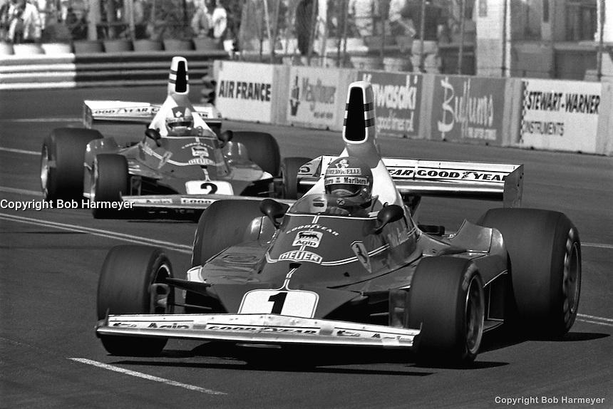 LONG BEACH, CA: Niki Lauda, #1 Ferrari 312T 023/Ferrari 015, and Clay Regazzoni, #2 Ferrari 312T 024/Ferrari 015, drive during the morning warmup session for the inaugural United States Grand Prix West on March 28, 1976, on the temporary street circuit in Long Beach, California.