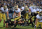 Sept. 14, 2013; Running back Cam McDaniel (33) bursts through the line of scrimmage for Notre Dame's first touchdown.<br /> <br /> Photo by Matt Cashore
