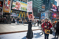 Drag Queen Epiphany Get Paid protests in Times Square in New York on Sunday, February 24, 2013 about the pastor of St. Malachy's Church's complaints about a her drag show taking place next door to the church in Lillie's restaurant. The two parties settled amicably and the show, which consisted of Ms. Paid primarily singing show tunes, went on as planned.  (© Richard B. Levine)