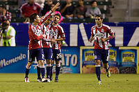 Chivas USA midfielder Jorge Flores celebrates his goal with teammates. Chivas USA defeated Toronto FC 3-0 at Home Depot Center stadium in Carson, California on Saturday October 9, 2010.