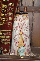 Torah scroll at the Ibn Danan Synagogue, built by Mimoun Ben Sidan in the 17th century, in the Mellah or Jewish quarter, Fes, Fes-Boulemane, Northern Morocco. The Synagogue is plainly decorated and contains a carved wooden Torah Ark and a raised alcove seating area shielded by a carved wooden screen. The synagogue was restored in the 1870s and 1990s. Picture by Manuel Cohen