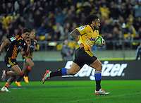 Ma'a Nonu heads for the tryline during the Super Rugby match between the Hurricanes and Chiefs at Westpac Stadium, Wellington, New Zealand on Saturday, 16 May 2015. Photo: Dave Lintott / lintottphoto.co.nz