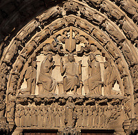 On the tympanum, Christ holds up his arms to show his wounds, while Mary and St John the Baptist sit on either side and behind them kneel angels holding the pillar, whip and spear. Above, angels hold the nail, cross, shroud and crown of thorns. On the lintel, the archangel Michael separates those souls going to heaven on the left and hell on the right. On the archivolts, the hierarchy of the angels. Central bay of the South Portal depicting the Last Judgement, 12th century, Chartres Cathedral, Eure-et-Loir, France. Chartres cathedral was built 1194-1250 and is a fine example of Gothic architecture. It was declared a UNESCO World Heritage Site in 1979. Picture by Manuel Cohen.