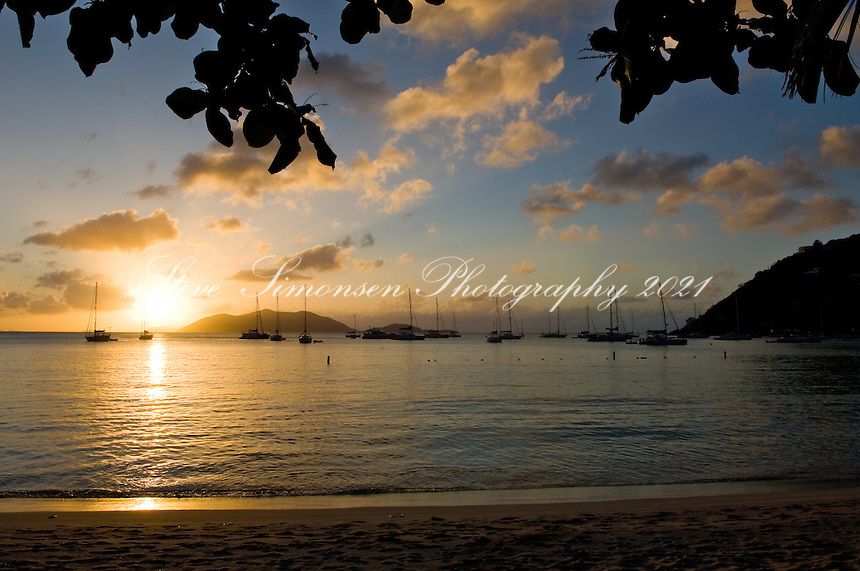 Sunset over Jost Van Dyke from the beach at Cane Garden Bay, Tortola, British Virgin Islands