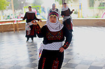 Iman al-Tanani, a 28-year-old a Palestinian woman with Down syndrome wears a traditional dress, as she dances dabka in Gaza city on Feb. 16, 2017. al-Tanani got work from United Nations Relief and Works Agency (UNRWA) on handmade, moreover she playing basketball and dance Dabka. Photo by kholoud Lafi