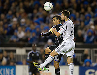 Tommy Meyer of Galaxy fights for the ball in the air against Chris Wondolowski of Earthquakes during the game at Buck Shaw Stadium in Santa Clara, California on November 7th, 2012.   LA Galaxy defeated San Jose Earthquakes, 3-1.