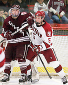 Austin Smith (Colgate - 9), Dan Ford (Harvard - 5) - The Harvard University Crimson defeated the visiting Colgate University Raiders 6-2 (2 EN) on Friday, January 28, 2011, at Bright Hockey Center in Cambridge, Massachusetts.