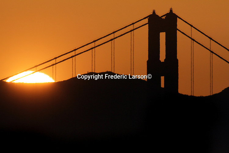 The sunset behind the north tower of the Golden Gate Bridge on Saturday, May 5, 2012.