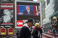 Passer-by gather in Times Square in New York on Monday, January 21, 2013 to watch the inauguration of Barack Obama for his second term as the 44th President of the United States. (© Frances M. Roberts)