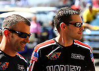 Jul. 20, 2014; Morrison, CO, USA; NHRA pro stock motorcycle rider Andrew Hines (right) and teammate Eddie Krawiec during the Mile High Nationals at Bandimere Speedway. Mandatory Credit: Mark J. Rebilas-