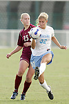 11 November 2007: North Carolina's Kristi Eveland (32) plays the ball away from Florida State's Sanna Talonen (25). The University of North Carolina defeated Florida State University 1-0 at the Disney Wide World of Sports complex in Orlando, FL in the Atlantic Coast Conference Women's Soccer tournament final.