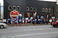 Austin, Texas - Tues., August 23, 2016 - Protesters of Republican presidential candidate Donald Trump line Lavaca street and hold up signs to vehicles passing by in downtown Austin to protest Trump&rsquo;s visit to the capital city. <br />
