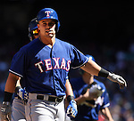 Texas Rangers'  Jake Somlinksi is greeted at home after hitting a two-run homer against the Seattle Mariners in the third inning at SAFECO Field in Seattle on April 10, 2015.  The Mariners came from behind to beat the Rangers 11-10.  Jim Bryant Photo. ©2015. All Rights Reserved.