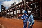 ITUMBIARA, BRAZIL - OCTOBER 16:<br /> Workers at the Rio Dourado Cargill plant near the city of Itumbiara, in Goias state, Brazil, on Wednesday, Oct. 16, 2013. Since the US recently passed a number of regulations and standards for cars and dropped tariffs that were in place for decades against Brazilian sugar, Brazilian ethanol is now flowing to the U.S., and the ethanol industry in the country is consolidating and ramping up for a new era.