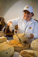 Gran Sasso National Park, Abruzzo, Italy, June 2008. All kinds of Pecorino cheese from the Abruzzo. The medieval town of Santo Stefano di Sessanio lies on a hill overlooking the valley. Photo by Frits Meyst/Adventure4ever.com