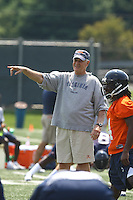 Virginia head coach Al Groh with Vic Hall during open spring practice for the Virginia Cavaliers football team August 7, 2009 at the University of Virginia in Charlottesville, VA. Photo/Andrew Shurtleff