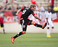 Nick DeLeon (18) of D.C. United follows through on a shot during the quarterfinals of the US Open Cup at the Maryland SoccerPlex in Boyds, Md.  D.C. United defeated the New England Revolution, 3-1.