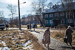 People leave church after services on Sunday, October 20, 2013 in Baikalsk, Russia.
