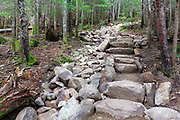 July 2016 - Newly built stone steps along the Mount Tecumseh Trail in Waterville Valley, New Hampshire during the summer months. Minimal stonework should be done along trails, and it should look natural and blend in with the surroundings.