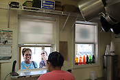 Copyright Justin Cook | September 26, 2013 - Customers order at the window at Saltbox Seafood Joint.