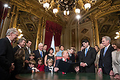 United States President Donald Trump turns to House Speaker Paul Ryan as he is joined by the Congressional leadership and his family as he formally signs his cabinet nominations into law, in the President's Room of the Senate, at the Capitol in Washington, Friday, Jan. 20, 2017. <br /> Credit: J. Scott Applewhite / Pool via CNP
