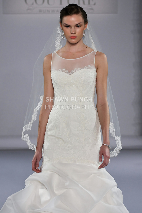 Model walks runway in a wedding dress from the Paloma Blanca collection, for the Couture Runway Show, during New York Bridal Fashion Week at The Hilton Hotel, October 13, 2012.