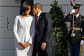 U.S. President Barack Obama (R) and first lady Michelle Obama wait for the arrival of British Prime Minister David Cameron during an official arrival ceremony on the South Lawn of the White House March 14, 2012 in Washington, DC. Prime Minister Cameron is on a three-day visit to the U.S. and he is expected to have talks with Obama on the situations in Afghanistan, Syria and Iran.  .Credit: Chip Somodevilla / Pool via CNP