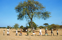 Sudan. South Sudan. Bahr El Ghazal. Anguoth. Christian Solidarity International (CSI) buys back dinka slaves from muslim arab traders.  Free slaves walking  to the next village. © 1999 Didier Ruef