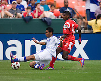 Armando Cooper (11) of Panama goes up for a header with Reynaldo Hernandez (19) of El Salvador  during the game at RFK Stadium in Washington, DC.  Panama defeated El Salvador on penalty kicks, 5-3, after tying, 1-1,  in regulation time.