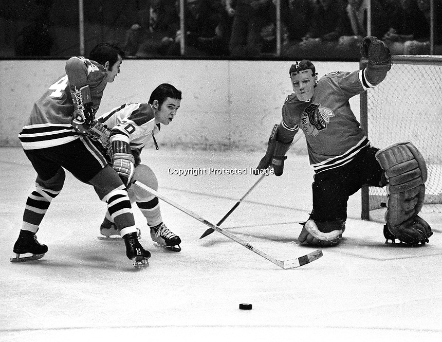 Seals vs Black Hawks: Ernie Hicke tries to score against Bryan Campbell and goalie Gerry Desjardins..(1970 photo by Ron Riesterer)