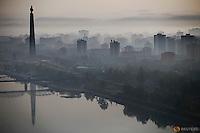 The 170-metre (558-feet) tall Juche Tower is reflected in Taedong River as morning fog blankets Pyongyang, North Korea May 5, 2016.  REUTERS/Damir Sagolj