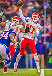 9 November 2014: Kansas City Chiefs quarterback Alex Smith makes a pass in the first quarter against the Buffalo Bills at Ralph Wilson Stadium in Orchard Park, NY. The Chiefs rallied with two fourth quarter touchdowns to defeat the Bills 17-13. Mandatory Credit: Ed Wolfstein Photo *** RAW (NEF) Image File Available ***