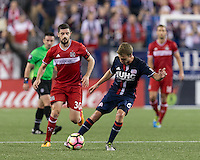 Foxborough, Massachusetts - August 9, 2016: First half action. 2016 Lamar Hunt U.S Open Cup Semifinal, New England Revolution (blue) vs Chicago Fire (red), at Gillette Stadium.