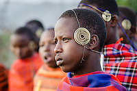 A Maasai boy, wearing a headdress that shows he's been recently circumsized and is entering warrior training.