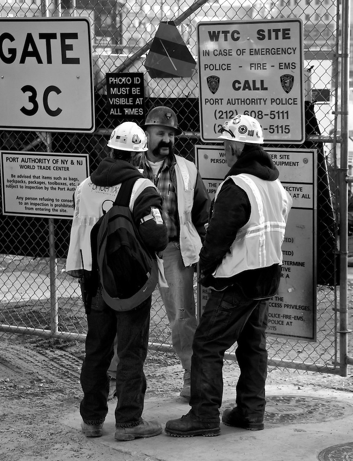 Construction workers chatting at construction site in ground zero, New York City, NY. November 2008