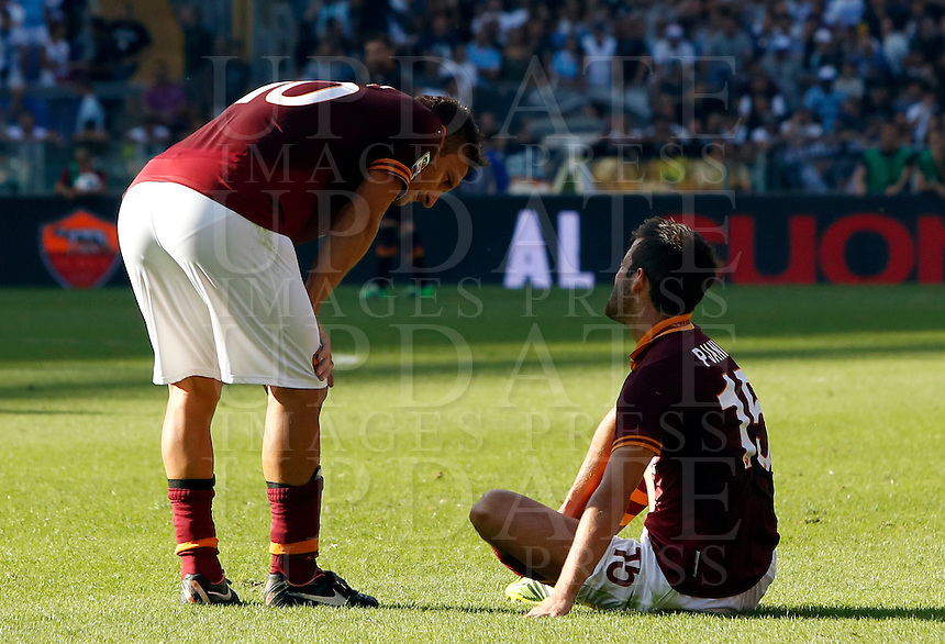 Calcio, Serie A: Roma vs Lazio. Roma, stadio Olimpico, 22 settembre 2013.<br /> AS Roma forward Francesco Totti, left, talks to teammate Miralem Pjanic, of Bosnia, during the Italian Serie A football match between AS Roma and Lazio, at Rome's Olympic stadium, 22 September 2013.<br /> UPDATE IMAGES PRESS/Riccardo De Luca
