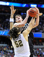 Andrew Smith of the Bulldogs is fouled by Panthers' Gary McGhee. Butler upset no.1 seed Pittsburgh 71-70 during the 3rd round of the NCAA Tournament at the Verizon Center in Washington, D.C on Saturday, March 19, 2011. Alan P. Santos/DC Sports Box