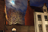 BRUGES, BELGIUM - FEBRUARY 07 : A low angle view of a Beguine's house with a sparkling moon in a piece of turquoise blue sky on February 07, 2009 in Bruges, Western Flanders, Belgium. The 'Beguinage of the Vineyard' was founded in the first half of the 13th century during the reign of Margaret of Constantinople. (Photo by Manuel Cohen)