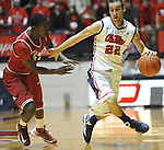 "Mississippi's Marshall Henderson (22) is defended by Arkansas' Fred Gulley (12) at the C.M. ""Tad"" Smith Coliseum in Oxford, Miss. on Saturday, January 19, 2013. Mississippi won 76-64. (AP Photo/Oxford Eagle, Bruce Newman)"
