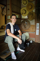 French WWOOF volunteer Paul Gaumer at Brown's Field, Isumi, Chiba Prefecture, Japan, August 8, 2009.The organic farm introduces healthy and sustainable living in the Japanese countryside. It is staffed by the Brown family and volunteers from around the world.