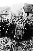 Adolf Hitler, accompanied by other German officials, grimly inspects bomb damage in a German city in 1944, in this German film captured by the U.S. Army Signal Corps on the western front. Ca. 1944.  (Army)<br /> Exact Date Shot Unknown<br /> NARA FILE #:  111-SC-197660<br /> WAR &amp; CONFLICT BOOK #:  1088