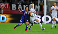 Megan Rapinoe (r) of team USA and Shinobu Ohno of team Japan during the FIFA Women's World Cup Final USA against Japan at the FIFA Stadium in Frankfurt, Germany on July 17th, 2011.