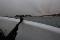 The Zawiyah refinery is seen from a boat during surveillance operations carried out by the coastguard in the west of Libya.