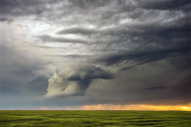 Country scene in USA with dramatic cloud formation above farmland