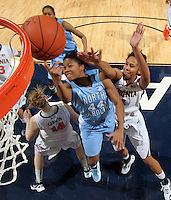 CHARLOTTESVILLE, VA- JANUARY 5: Tierra Ruffin-Pratt #44 of the North Carolina Tar Heels shoots between Virginia Cavalier defenders during the game on January 5, 2012 at the John Paul Jones arena in Charlottesville, Virginia. North Carolina defeated Virginia 78-73. (Photo by Andrew Shurtleff/Getty Images) *** Local Caption *** Tierra Ruffin-Pratt