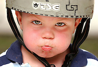 Palmetto Beach Three-year-old Kyle Skyles, of Seffner, Fla., puffs his cheeks with a mouth full of soda while taking a break from his scooter at DeSoto Skate Park in Palmetto Beach Monday. Skyles came to the park with his grandmother Marguerite Williams.  Julie Busch