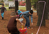 NWA Democrat-Gazette/BEN GOFF @NWABENGOFF<br /> Noah Roberts, 7, of Bella Vista and other 1st-3rd grade children hunts eggs on Saturday March 12, 2016 during the annual Easter egg hunt at First United Methodist Church of Bella Vista.
