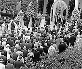 Washington, D.C. - June 12, 1971 -- United States President Richard M. Nixon walks his daughter Tricia down the aisle of the Rose Garden of the White House in Washington, D.C. on Saturday, June 12, 1971 during the marriage ceremony of Tricia to Edward Cox, who is standing to the immediate right of the minister..Credit: Bernie Boston / Pool via CNP