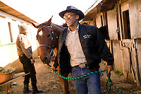 2 December 2006 - New York City, NY - Eric Jackson, aka Cowboy Little Red, a member of the Federation of Black Cowboys, walks his horse at the Cedar Lanes stables in the borough of Queens in New York City, USA, 2 December 2006. The Federation gathers black men and women who recreate the heritage of black cowboys, teach kids to ride and put on 'rodeo showdeos'.